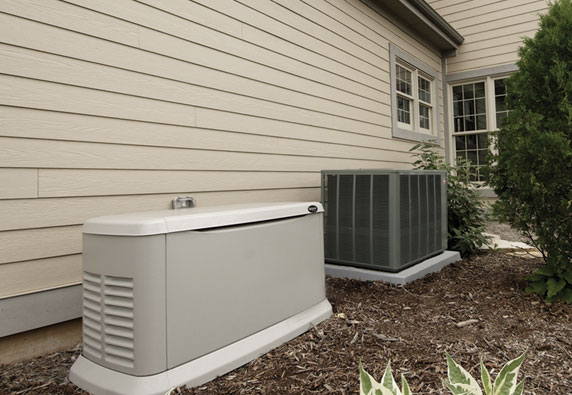 Whole house generator installed next to residential AC