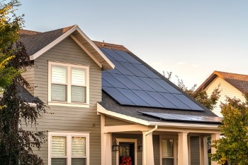 Large solar array covers entire roof of home